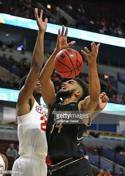 Sanjay Lumpkin of the Northwestern Wildcats is fouled by Kendall Pollard of the Dayton Flyers during the 2016 State Farm Chicago Legends game at the...
