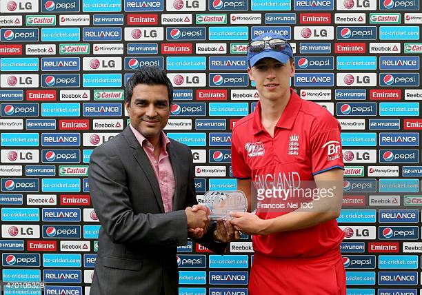 Sanjay Manjrekar presents Matthew Fisher of England with the man of the match award after the ICC U19 Cricket World Cup 2014 match between England...