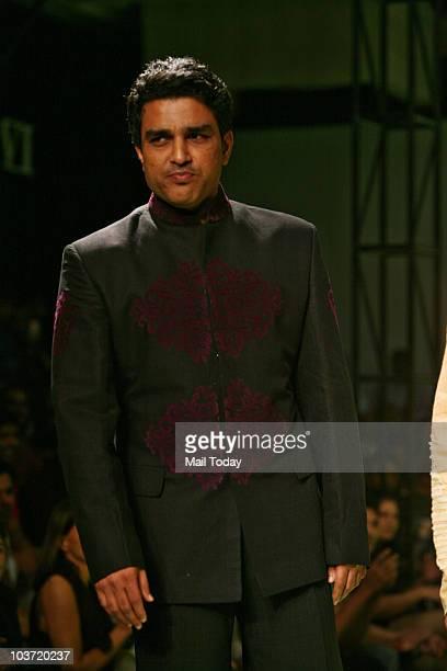 Sanjay Manjrekar walks the ramp for designer Manoviraj Khosla at the India Mens Week in New Delhi on August 28 2010
