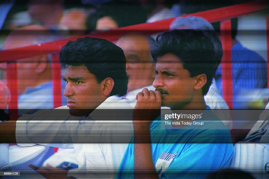 Sanjay Manjrekar with Javagal Srinath sitting in the stands and watching the match ( Cricket, News Portrait ) : News Photo