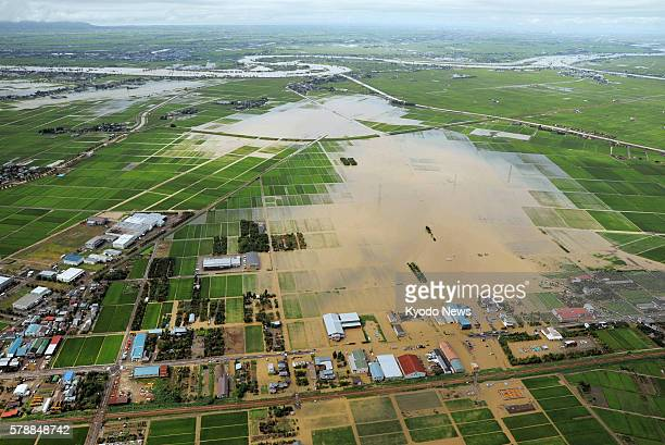 Sanjo Japan Downpour leaves rice paddies and houses flooded in an area straddling Sanjo and Kamo in Niigata Prefecture in a photo from a Kyoto News...
