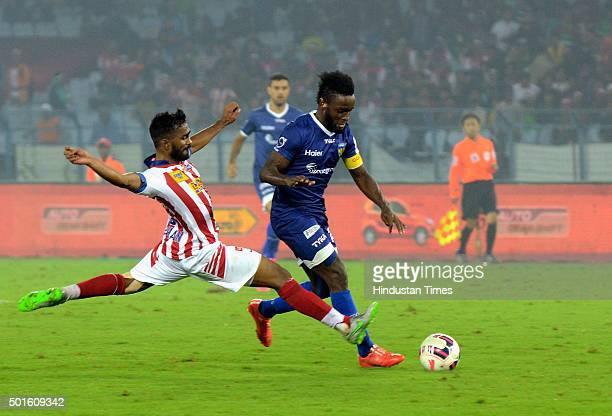 Sanju Pradhan of Atletico de Kolkata and Stiven Mendoza of Chennaiyin FC in action during their ISL semifinal second leg match at Yuva Bharati...