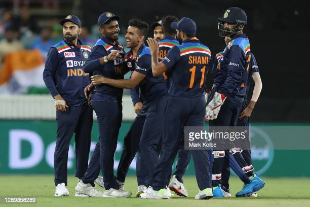 Sanju Samson of India and Yuzvendra Chahal of India celebrate the wicket of Steve Smith of Australia during game one of the Twenty20 International...