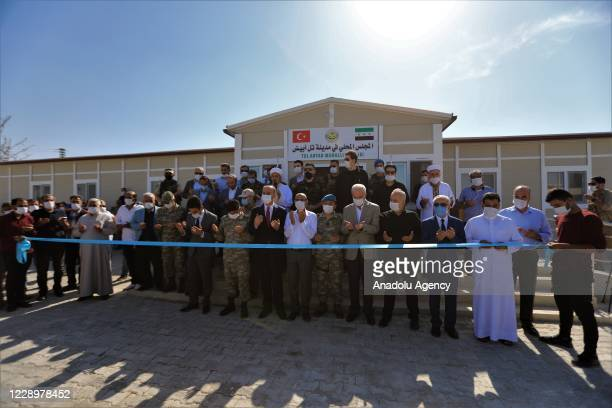 Sanliurfa Governor Abdullah Erin and accompanying delegation and other local leaders attend the opening ceremony of a local council building held on...