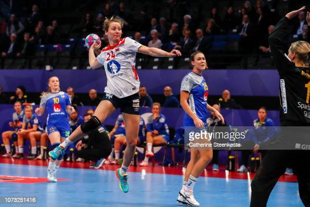 Sanna Charlotte Solberg of Norway shoots the ball on target against Johanna Bundsen of Sweden during the EHF Euro match for the classification 56...