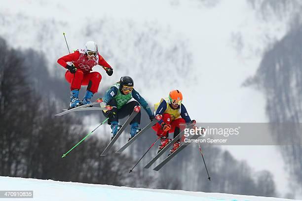Sanna Luedi of Switzerland Katya Crema of Australia Nikol Kucerova of Czech Republic compete in the Freestyle Skiing Womens' Ski Cross 1/8 Finals on...