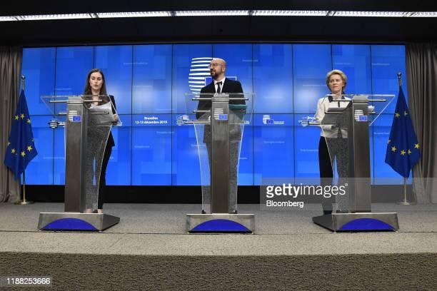 Sanna Marin Finland's prime minister left speaks alongside Charles Michel president of the European Union center and Ursula von der Leyen president...
