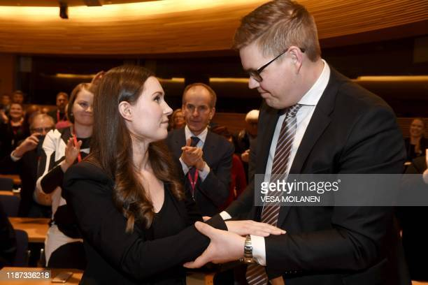 Sanna Marin of Finland's Social Democrates is congratulated by her contender Antti Lindtman after she was elected to the post of Prime Minister in...