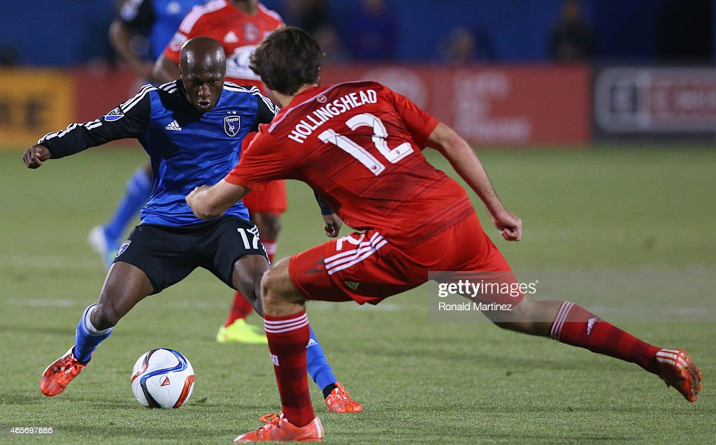 Sanna Nyassi #17 of San Jose Earthquakes dribbles the ball against Ryan Hollingshead #12 of FC Dallas at Toyota Stadium on March 7, 2015 in Frisco, Texas.