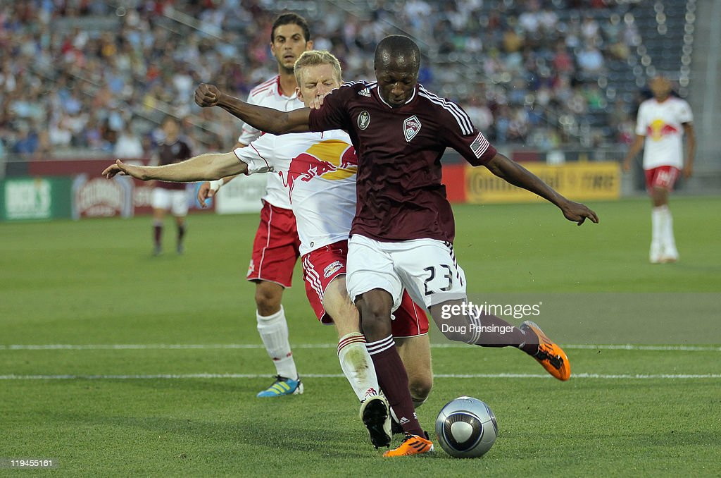 Sanna Nyassi #23 of the Colorado Rapids beats the defense of Tim Ream #5 of the New York Red Bulls to score his second goal of the game in the 31st minute to give the Rapids a 3-0 lead at Dick's Sporting Goods Park on July 20, 2011 in Commerce City, Colorado.