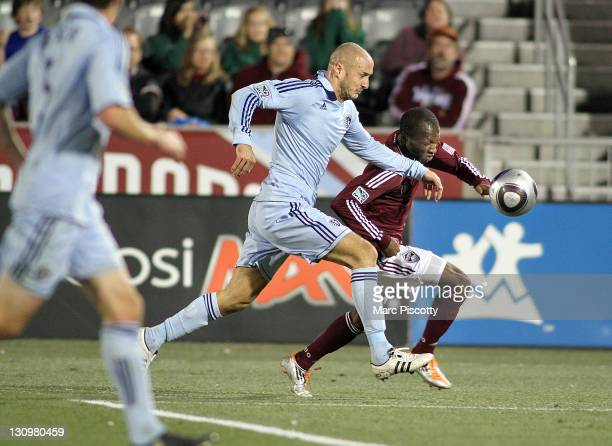 Sanna Nyassi of the Colorado Rapids tries to get past Aurelien Collin of Sporting Kansas City during their Eastern Conference Semifinals game at...