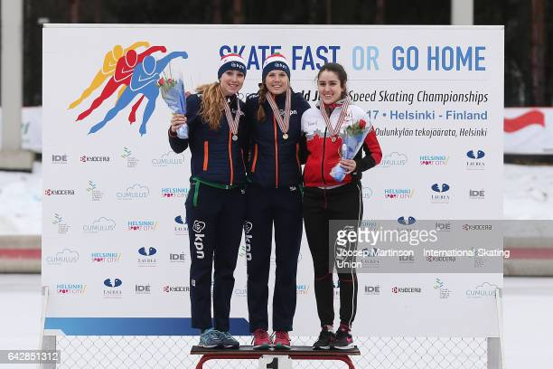 Sanne In 't Hof and Elisa Dul of Netherlands and Beatrice Lamarche of Canada pose in the ladies mass start medal ceremony during day three of the...