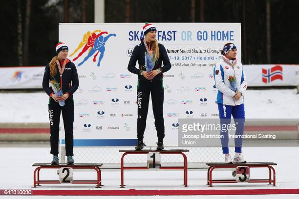 Sanne In 't Hof and Jutta Leerdam of Netherlands and Daria Kachanova of Russia pose in the Ladies 1500m medal ceremony during day one of the World...