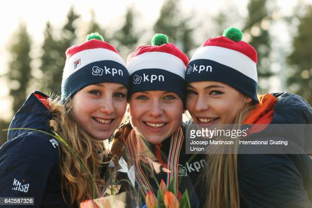 Sanne In 't Hof, Joy Beune and Jutta Leerdam of Netherlands pose in the ladies 3000m medal ceremony during day two of the World Junior Speed Skating...