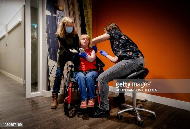 Sanne , sit in a wheelchair, receives a Covid-19 vaccine in the care centre Het Westerhonk - 's Heeren Loo in Monster, The Netherlands, on January 18...