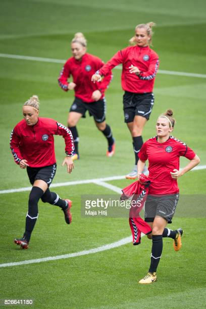Sanne Troelsgaard and Katrine Veje of Denmark warm up during a training prior UEFA Women's Euro 2017 Final against Netherlands at De Grolsch Veste...