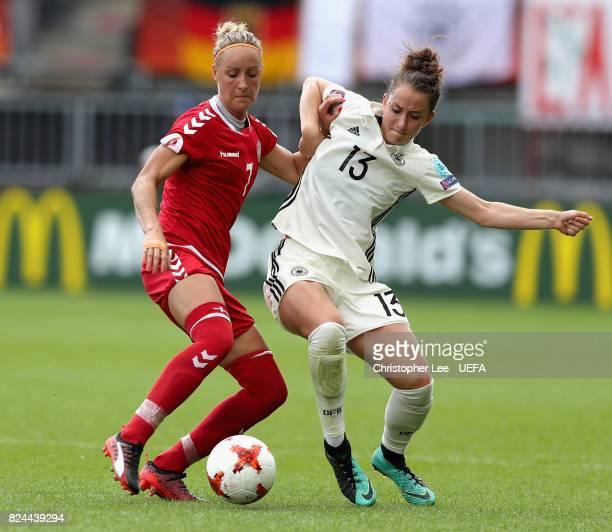 Sanne Troelsgaard Nielsen of Denmark and Sara Dabritz of Germany battle for possession during the UEFA Women's Euro 2017 Quarter Final match between...