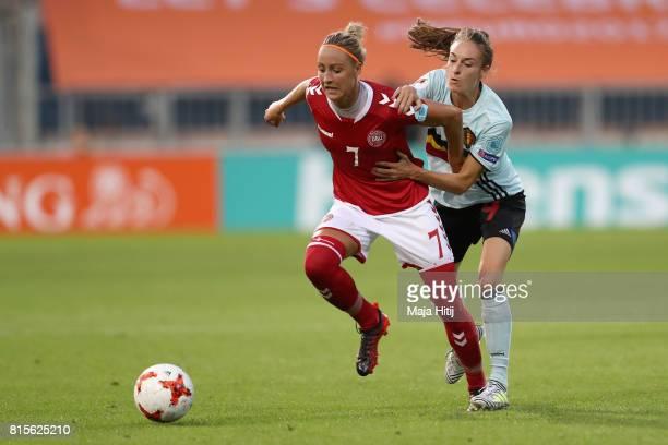 Sanne Troelsgaard Nielsen of Denmark and Tessa Wullaert of Belgium battle for possession during the Group A match between Denmark and Belgium during...
