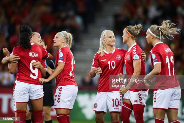 Sanne Troelsgaard Nielsen of Denmark celebrates scoring her sides first goal with Pernille Harder of Denmark during the Group A match between Denmark...