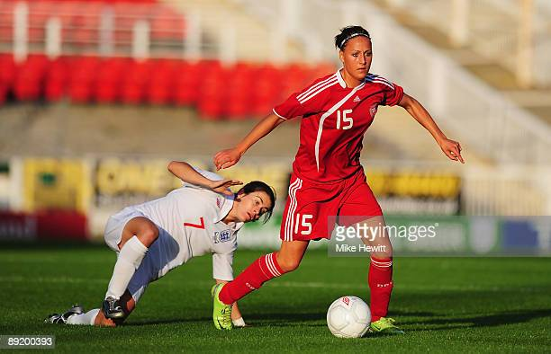 Sanne Troelsgaard Nielsen of Denmark is challenged by Karen Carney of England during a Women's International friendly match between England and...