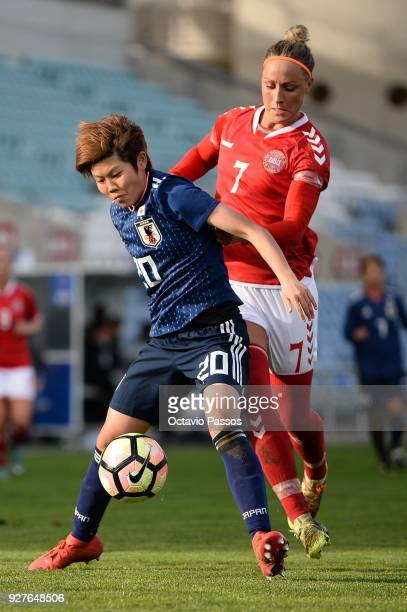 Sanne Troelsgaard of Denmark competes for the ball with Shiori Miyake of Japan during the Women's Algarve Cup Tournament match between Denmark and...