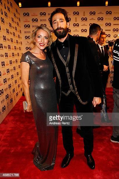Sanny van Heteren and Adrien Brody arrive at the GQ Men of the Year Award 2014 at Komische Oper on November 6 2014 in Berlin Germany