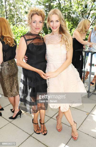 Sanny Van Heteren and Julia Dietze attend the unveiling of the Isabell Kristensen Couture 2017 Cannes Red Carpet Collection at the JW Marriott on May...