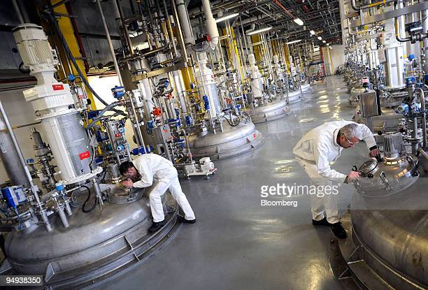 SanofiAventis SA technicians check the cleanliness of a reactor at the company's laboratory in Neuville sur Sane Rhne France on Tuesday Feb 10 2009...