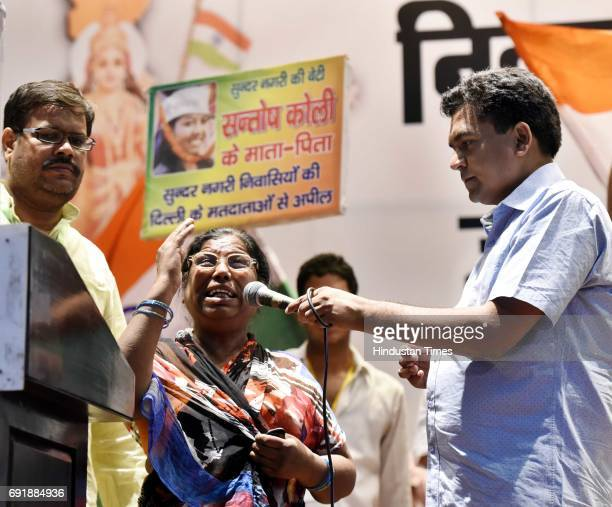 Sanotsh Kohli's mother Kala Wati with former Delhi Minister Kapil Mishra during the launch of programme 'India Against Corruption2' against Arvind...