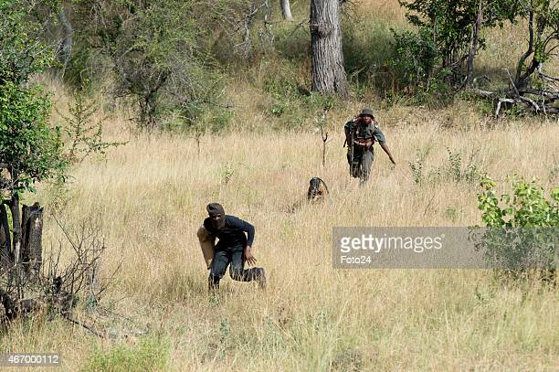 SANParks ranger police and members of the SANDF during an antipoaching demonstration on March 18 2015 at the Kruger National Park in Skukuza South...