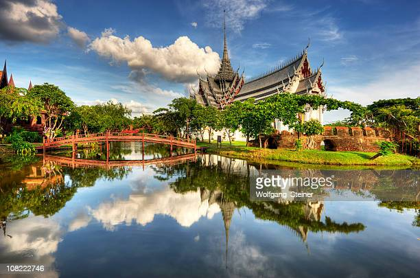 Sanphet Prasat Palace with a lake and bridge in front