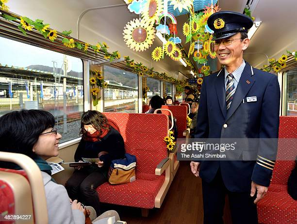 Sanriku Railway Co Operation Manager Junichi Konno welcomes the passengers of the first train at Kamaishi station on April 5 2014 in Kamaishi Iwate...