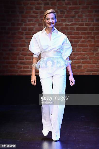 Sansim Adali is applauded on the runway at the Sudietuz show during MercedesBenz Fashion Week Istanbul at Zorlu Center on October 14 2016 in Istanbul...
