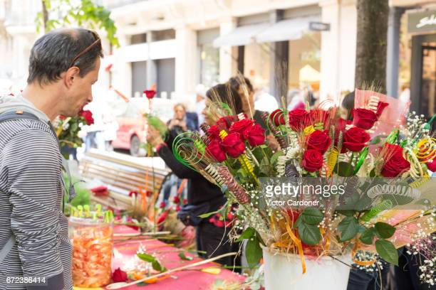 sant jordi's day celebration in barcelona, catalonia - saint george's day - roses catalonia stock pictures, royalty-free photos & images