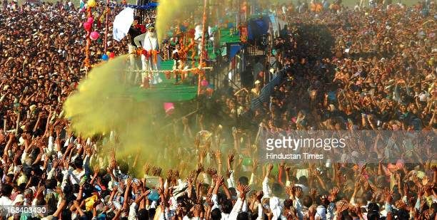 Sant Shri Asaram Bapu sprinkling colored water on his thousands of followers as part of Holi celebrations in Kumbh Mela on March 9 2013 in Allahabad...