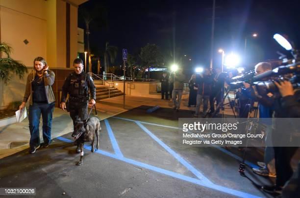 Santa Ana police officer Luis Galeana and Dr Lisa Gould walk K9 officer Puskas out of Yorba Regional Animal Hospital in Anaheim on Tuesday Feb 27...