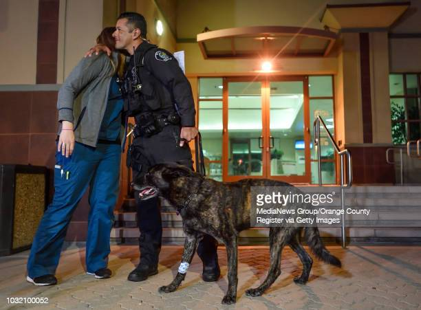 Santa Ana police officer Luis Galeana hugs Dr Lisa Gould as he leaves Yorba Regional Animal Hospital with K9 Officer Puskas in Anaheim on Tuesday Feb...