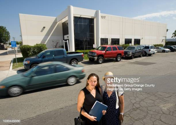 Santa Ana resident Dora Lopez at left and cochair of the Santa Ana Healthy Neighborhood Alliance Susana Sandoval stand on the street in front of the...