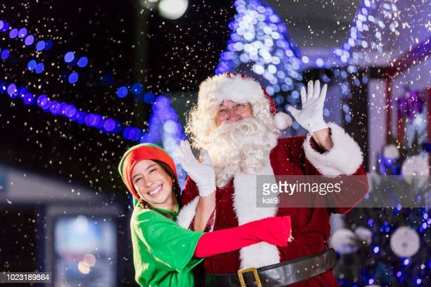 santa and elf at winter festival - pixie stock photos and pictures