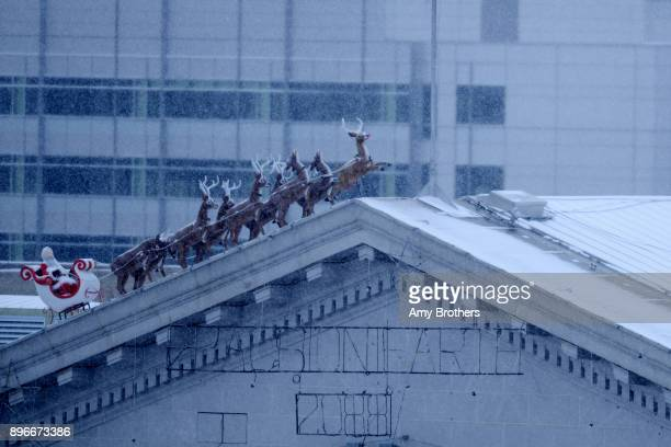 Santa and his raindear on top of City and County building on December 21 2017 in Denver Colorado An arctic blast brings snow and cold temps to Denver...