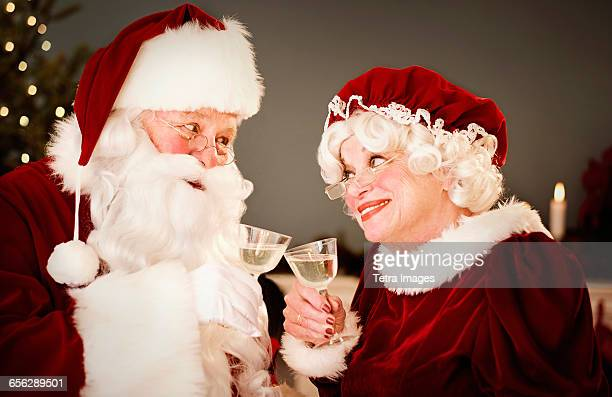 Santa and Mrs. Claus drinking champagne