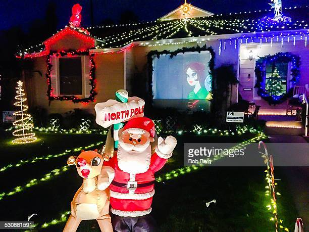 El Segundo Ca December 16 2014 Santa and Rudolph the red nosed reindeer and a video screen projection are part of a private homes Christmas lights...