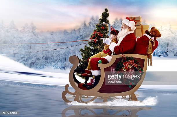 Santa and the little girl sat on a sled