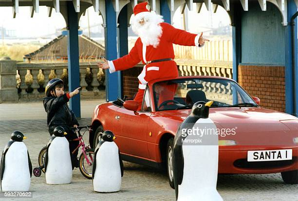 Santa arrived early in Redcar today and needed a little help to find his way home from three year old Stefan taylor 24th November 1995