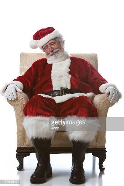 Santa adormecer em uma cadeira