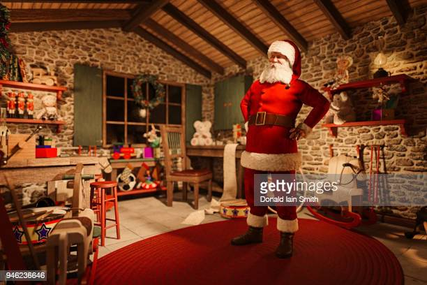 Santa at home in his workshop with toys he has made