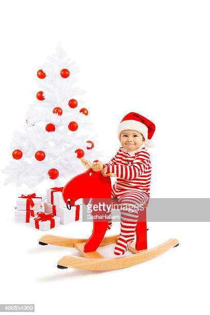Santa Baby with decorated Christmas Tree