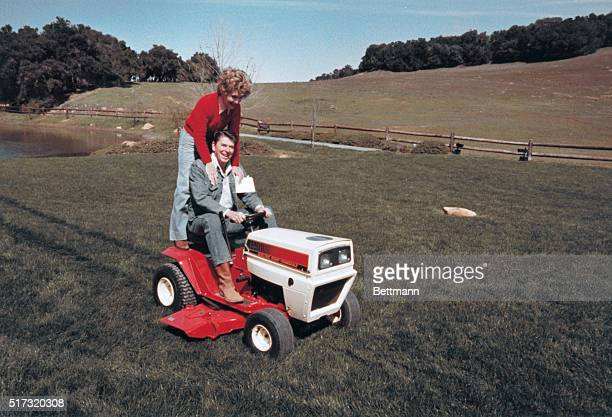 The President and Mrs Reagan ride the lawnmower presented by their friends for their 30th wedding anniversary at their ranch in Calif