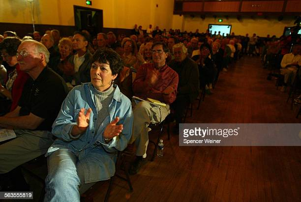 Santa Barbara County 3rd District Supervisor Gail Marshall left applauds speakers during town hall meeting held in April of this year to strategize...