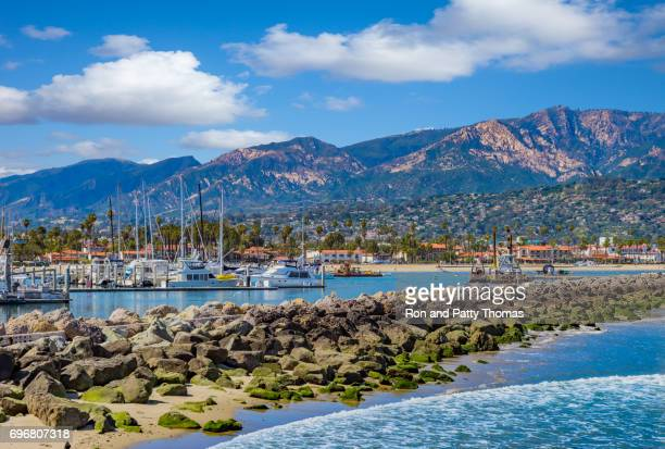 Santa Barbara Marina shoreline breakwater with recreational boats, CA